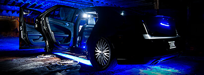 Black Chrysler 300 with blue LED lights interior