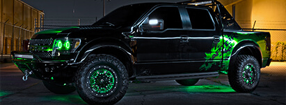 Ford F150 Raptor in black with green halo headlights